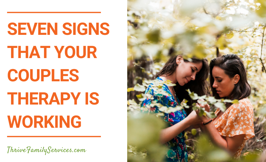 Text that reads: Seven Signs That Your Couples Therapy is Working next to a picture of two women in the woods, standing closely together. they are surrounded by leaves. Couples Therapy Greenwood Village